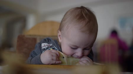 palačinka : Little boy funny eats a thin pancake in slow motion