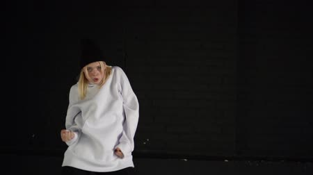 hiphop : Slow motion of the girl that dance hip hop in white clothe in black room. Stock Footage