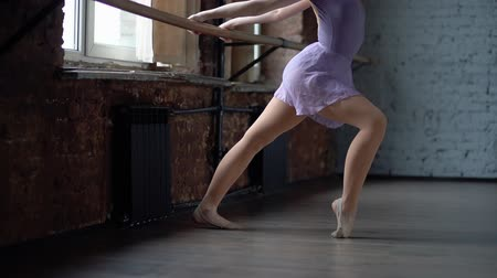 tüt : Legs of a ballerina are training in slow motion. Stok Video