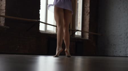 тапочка : Ballerine trains spin in the ballroom in slow motion.