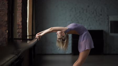 sapma : Blond ballerine trains her deflection near window.