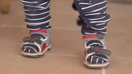 szandál : Cute little feets of the small kid in slow motion and stripes.