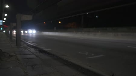 multiple lane : Cars move on the night road - low angle view.