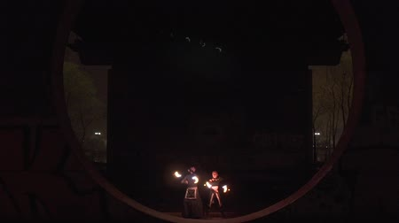 great story : Led and diode performance of the two artists man and woman at the night.