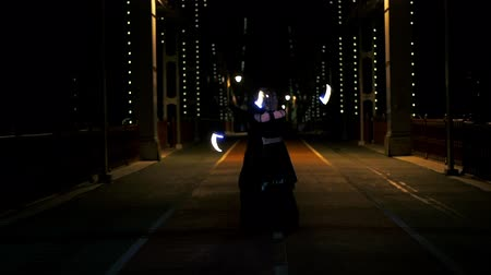 el feneri : Beautiful dance with led poi of circus artists man and woman on the empty bridge