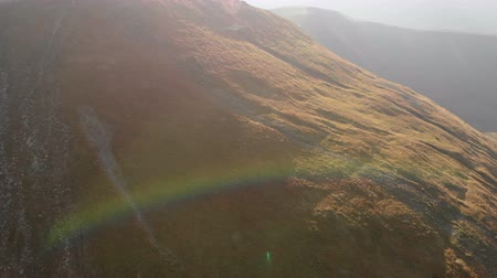 карпатская : Aerial shot of a Carpathian Mountain slope with a nice rainbow in 4k Стоковые видеозаписи