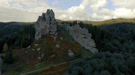 defensiva : Tustan, an old cliff-side fortress in the Carpathian Mountain on a sunny day