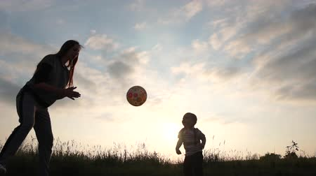hágó : Two year old boy plays the ball like volleyball player at sunset in slow motion