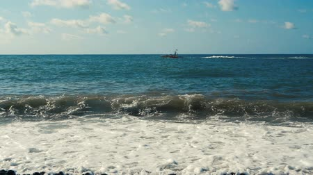 моторная лодка : Small powerboat floating along the Black Sea beach in summer in slo-mo