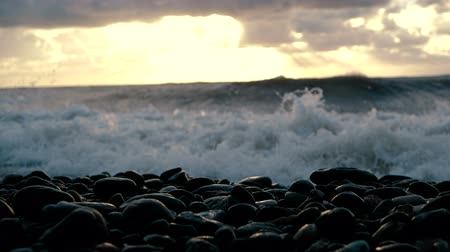 feroz : The rowdy Black Sea with stormy waves at splendid sunset in summer in slo-mo.