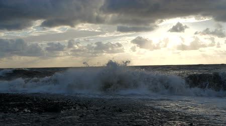 rampant : The formidable Black Sea with dashing high waves at sunset in summer in slo-mo.