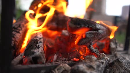 wood burner : Blue fire blazing under a metallic pot on a sunny day in summer in slow motion