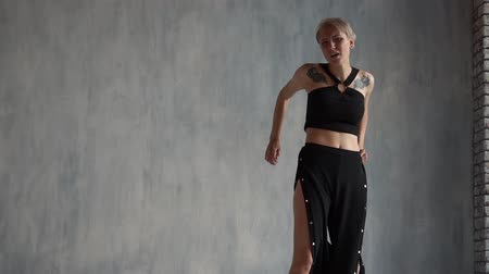 temyiz : Arty blonde girl waving her hands with despair and dancing like a bird in a studio in slo-mo Stok Video