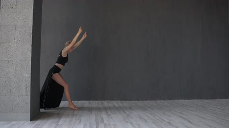 levegős : Stylish blonde girl doing roundoff while dancing contemporary in studio in slo-mo Stock mozgókép