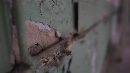 chernobyl : Old wall with ruined grey paint and a cracked line in Chernobyl house in slo-mo