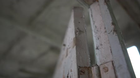 chernobyl : Shabby wall with old grey paint in an abandoned Chernobyl house in slo-mo