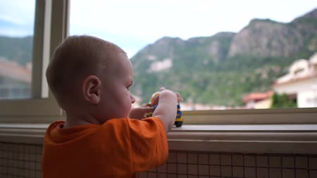sandpit : A boy looks out the window and is played by the truck in slow motion