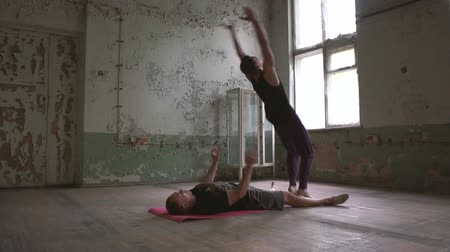 rundown : Two psycho men doing a handstand and a somersault in a shabby hall in slo-mo