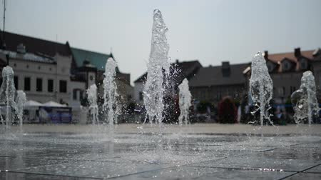スラブ : Hilarious fountain with many springs working in Krakow square in summer