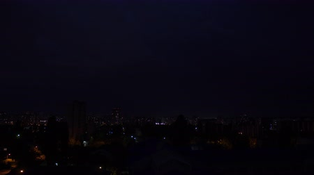 impressive skyline : Beautiful illuminated city night view in Ukraine during lightning