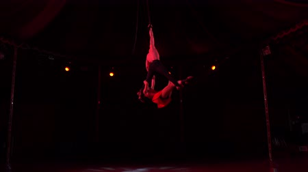soar : Beautiful aerial show of the pair of woman and strong man.
