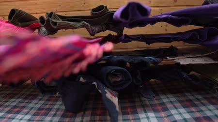 původní : Folk scarf and clothes drying on a brick balcony rope being shot down up