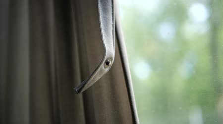 toka : Metal clasp close-up on the background of the window of a moving train, slow motion