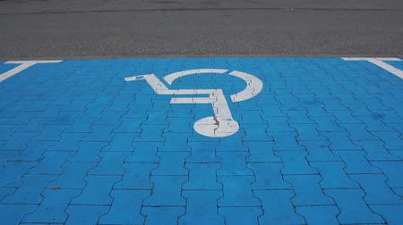 Disabled parking place in slow motion.