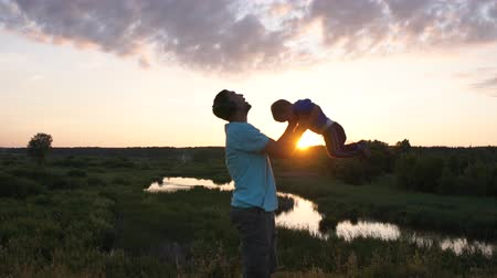 Father and son at sunset in slow motion. Stock mozgókép