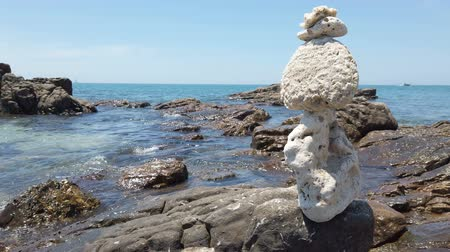 stacked rock : Zen stones balance at stony beach and sea background. 4K footage