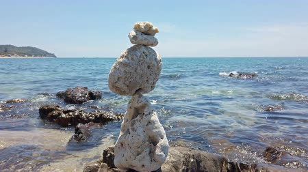 balanced : Zen stones balance at stony beach and sea background. 4K footage