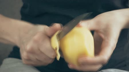 starch : Women`s hands cleaned with a knife ripe big potatoes Stock Footage
