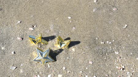 wavelets : Star toy on a sandy beach with surging ripples
