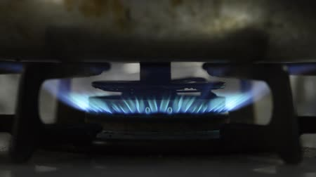 Gas stove blue flame that warms the kettle Stock Footage
