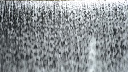levee : Close up artificial waterfall flowing all over from levee Stock Footage