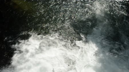 Falling white water of the weir from the top