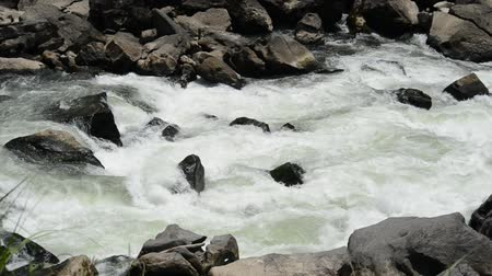 White fast river stream between a lot of rocks Stock Footage