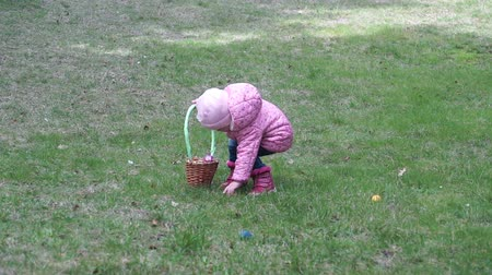 easter : Little girl collecting Easter eggs