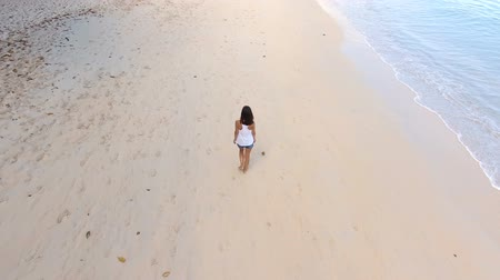 mahe : Aerial View Of A Beautiful Girl Walking Down The Beau Vallon Beach 4, Seychelles Stock Footage