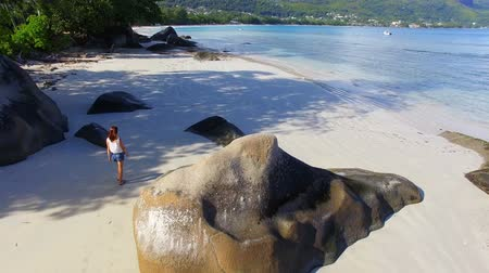 mahe : Aerial View Of A Beautiful Girl Walking Down The Beau Vallon Beach 1, Seychelles