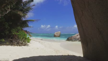 Walking Away From Luxury Beach, Anse Source dArgent, La Digue, Seychelles Stock Footage