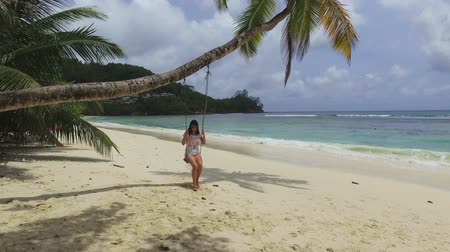 mahe : A Girl Swinging On A Palm Tree, Baie Lazare Beach, Seychelles