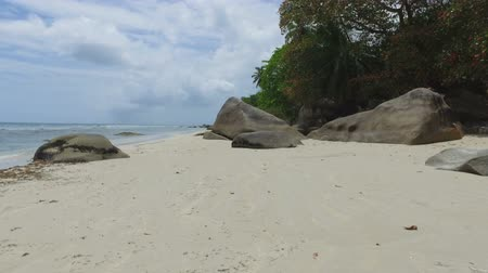 mahe : Walking Through The Rocks, Beau Vallon Beach, Mahe Island, Seychelles 1 Stock Footage