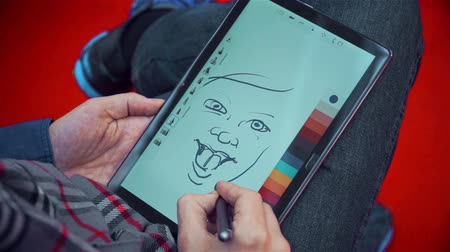 астрологический : person draws a caricature on a tablet