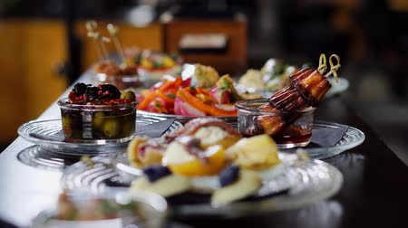 banquete : snacks for alcohol are reserved on the table in the restaurant Stock Footage