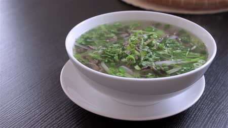 beef dishes : Vietnamese soup Pho Bo with chilli pepper Stock Footage