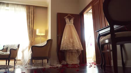 koronka : wedding dress and rose petals on the floor