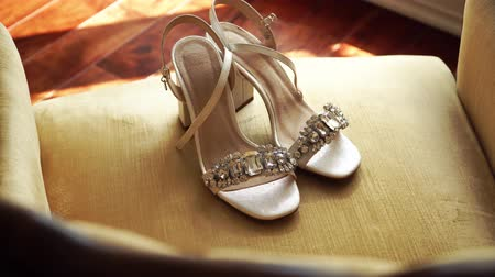 бежевый : luxury brides shoes at the armchair