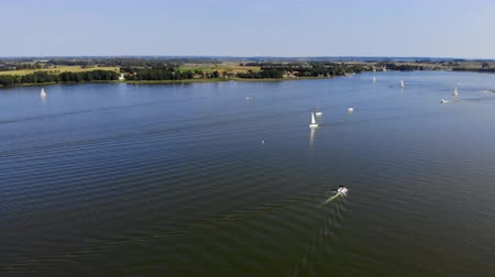 felhőtlen : Aerial view various yachts sailing on rippling sea water on sunny day on resort