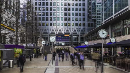 docklands : Timelapse of people rushing to work with several clocks in the docklands financial centre in London